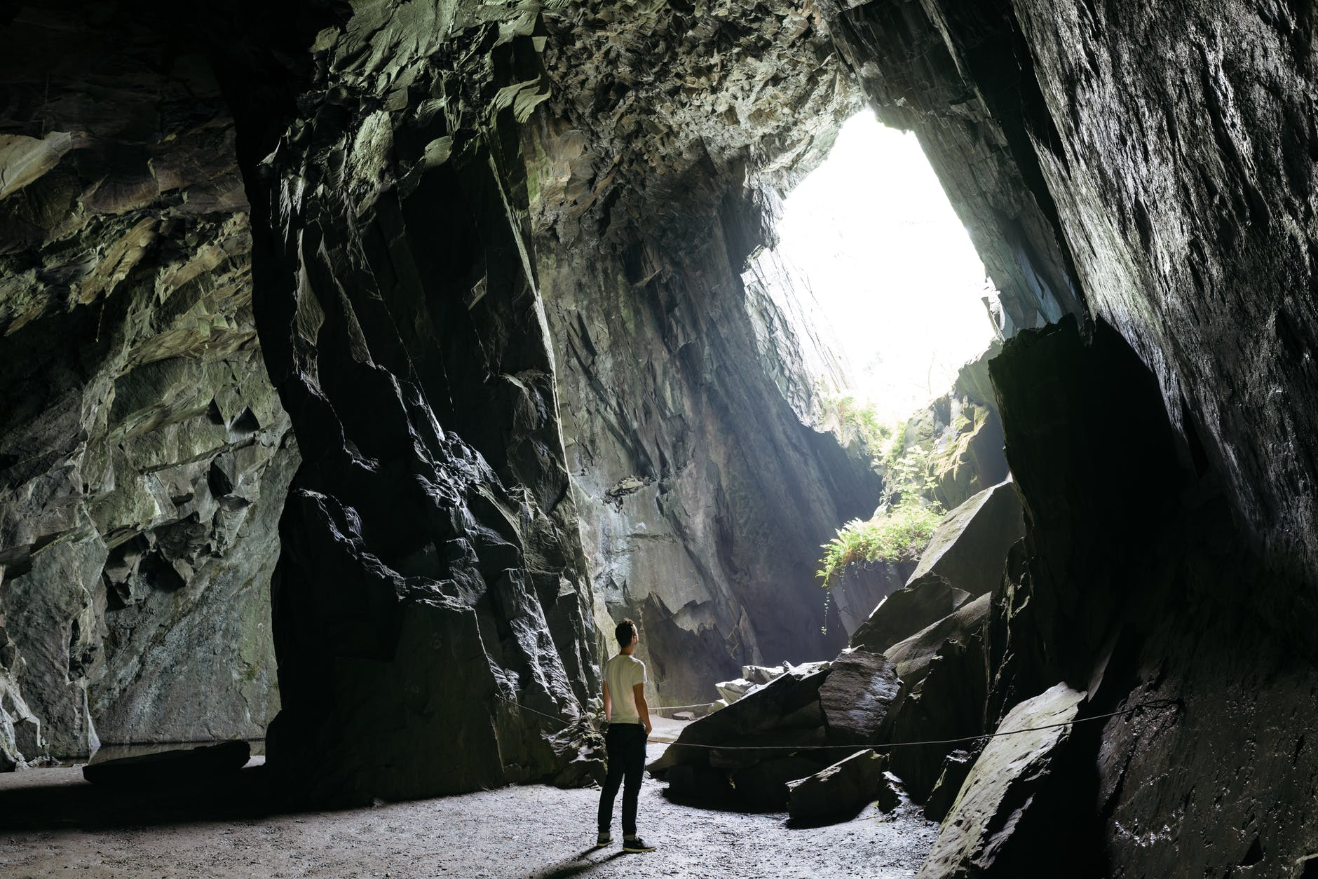 person standing inside cave